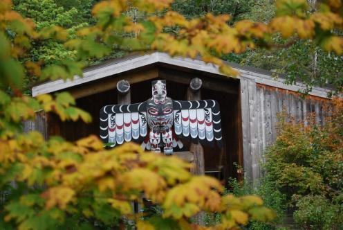 Photo of the iconic Thunderbird at the entrance of the Longhouse at Evergreen.